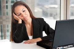 Businesswoman Sitting at Her Desk Sleeping Stock Photography