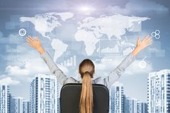 Businesswoman sitting with her hands outstretched Stock Image