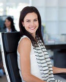 Businesswoman sitting in her workplace Stock Image