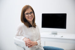 businesswoman sitting at her workplace Stock Image