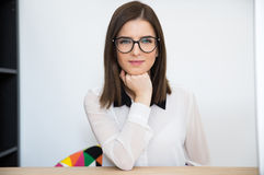 Businesswoman sitting at her workplace Stock Photo
