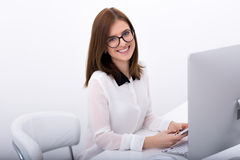 Businesswoman sitting at her workplace in office Stock Images