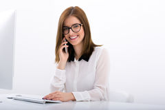 Businesswoman sitting at her workplace in office Royalty Free Stock Image