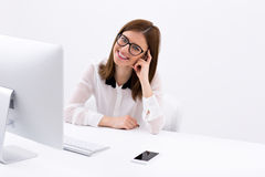 Businesswoman sitting at her worplace Royalty Free Stock Images