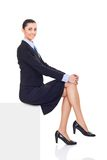 Businesswoman sitting on horizontal banner edge Stock Image