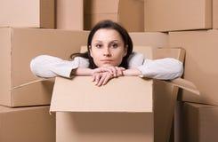Businesswoman sitting inside the box Stock Photo