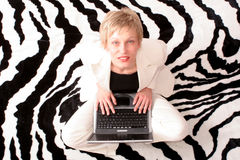Businesswoman sitting with laptop Stock Image