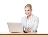 Businesswoman sitting with laptop Royalty Free Stock Image