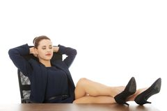 Businesswoman sitting with legs on desk Royalty Free Stock Photos