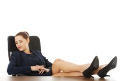 Businesswoman sitting with legs on desk Royalty Free Stock Photography