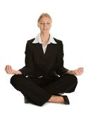 Businesswoman sitting in lotus flower position royalty free stock photography