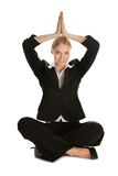 Businesswoman sitting in lotus flower position Stock Photo