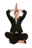 Businesswoman sitting in lotus flower position Stock Photo