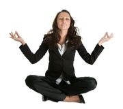 Businesswoman sitting in lotus flower position Stock Images