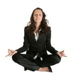 Businesswoman sitting in lotus flower position Royalty Free Stock Image