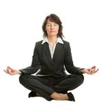 Businesswoman sitting in lotus position Stock Photo