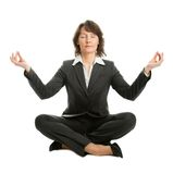 Businesswoman sitting in lotus position Stock Photos