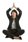 Businesswoman sitting in lotus position Royalty Free Stock Photos