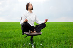 Businesswoman sitting in lotus position Royalty Free Stock Image