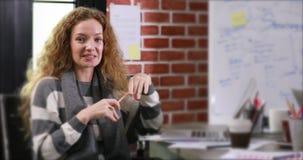 Businesswoman sitting in modern office. stock footage
