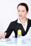 Businesswoman sitting near baby bottle. Royalty Free Stock Photos