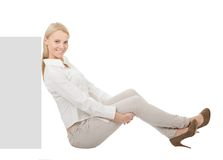 Businesswoman sitting next to copyspace Stock Photos