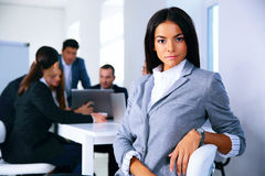 Businesswoman sitting on the office chair Stock Images
