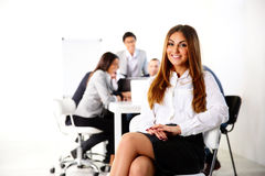 Businesswoman sitting on the office chair Royalty Free Stock Images