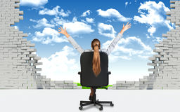 Businesswoman sitting on the office chair in front Stock Photos
