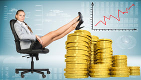 Businesswoman sitting on office chair with golden Stock Images