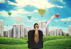 Businesswoman sitting on office chair. Green hills Royalty Free Stock Photos
