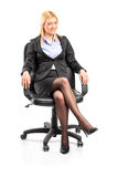 Businesswoman sitting in an office chair Stock Image