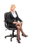 Businesswoman sitting on an office chair Stock Images