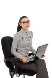 Businesswoman sitting in the office chair with laptop Stock Image