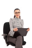 Businesswoman sitting in the office chair with laptop Stock Photos