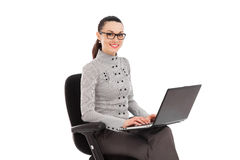 Businesswoman sitting in the office chair with laptop Stock Photography