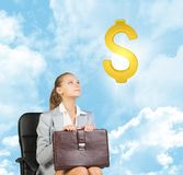 Businesswoman sitting on office chair, looking up Royalty Free Stock Photos
