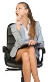 Businesswoman sitting on office chair with Royalty Free Stock Photography