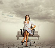 Businesswoman sitting on the office chair Stock Photo