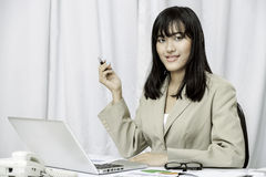 Businesswoman sitting in office Royalty Free Stock Photography