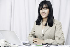 Businesswoman sitting in office Royalty Free Stock Image