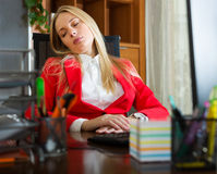 Businesswoman  sitting at office  with closed eyes Royalty Free Stock Image