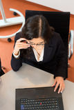 Businesswoman is sitting at office desk Royalty Free Stock Images