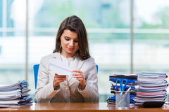 The businesswoman sitting at the office desk Stock Images