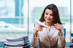 The businesswoman sitting at the office desk Stock Photography