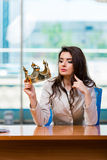 The businesswoman sitting at the office desk Royalty Free Stock Photos