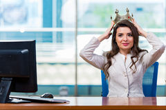 The businesswoman sitting at the office desk Stock Image