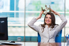 The businesswoman sitting at the office desk. Businesswoman sitting at the office desk Royalty Free Stock Image