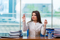 The businesswoman sitting at the office desk Royalty Free Stock Images