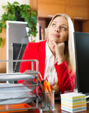 Businesswoman  sitting at office desk and dreaming Stock Images